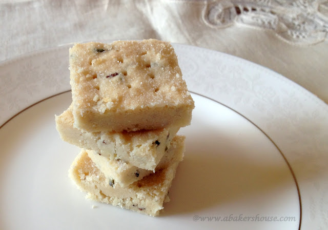A stack of four piece of lavender shortbread