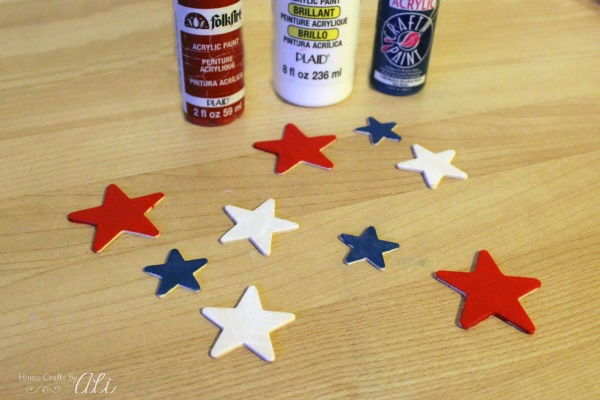 red white and blue painted wood stars