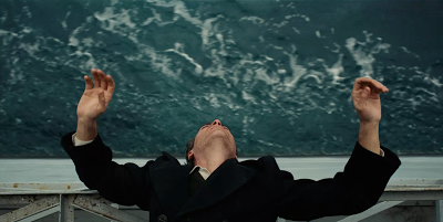 Joaquin Phoenix as Freddie Quell in The Master, enjoying the sea wind, directed by Paul Thomas Anderson