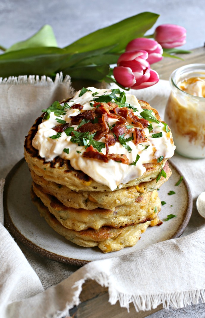 Recipe for corn and bacon fritters topped with yogurt and apricot preserves.