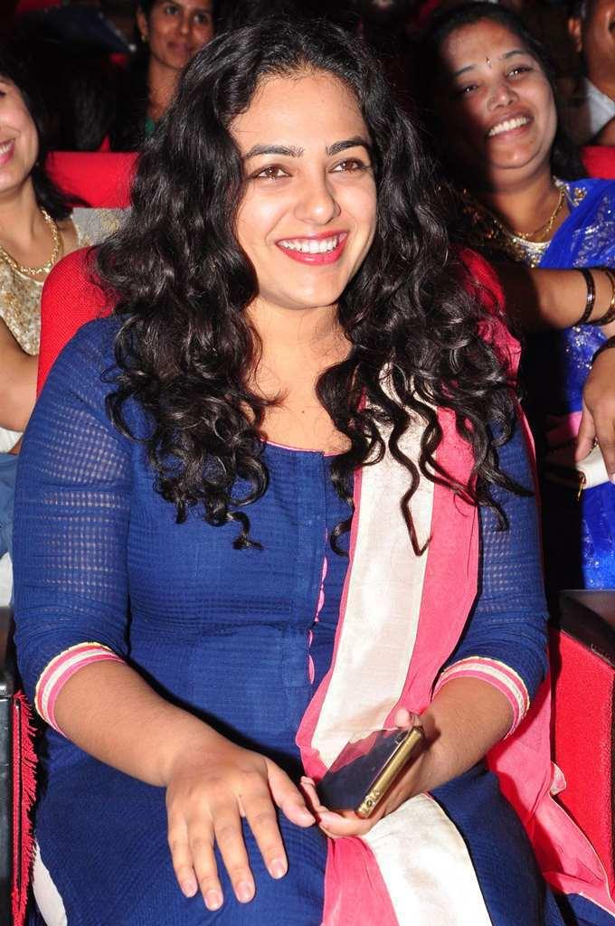Nithya Menen Smiling Stills At Film Audio Launch In Blue Dress