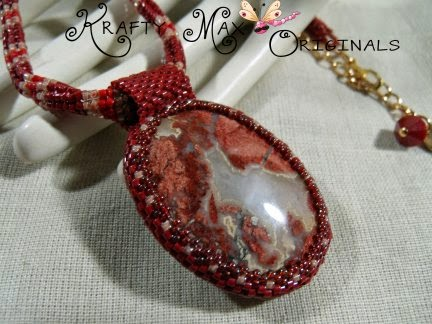 http://www.lajuliet.com/index.php/sell/ad/beadwork,46/red-velvet-and-cream-handmade-beadwoven-necklace-set-a-krafty-max-original-design,226