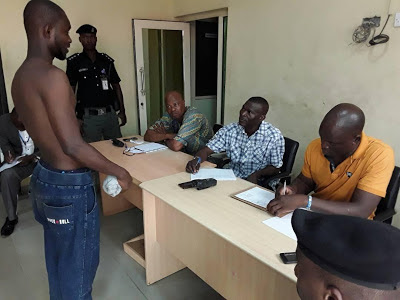 See Photos Of Arrested Suspected Baddo Gang Members Getting Screened By The Police