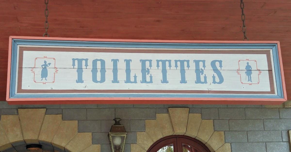 Si no bathroom sign