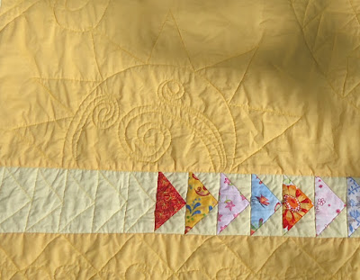 The sun coming up in the lower part of the quilt
