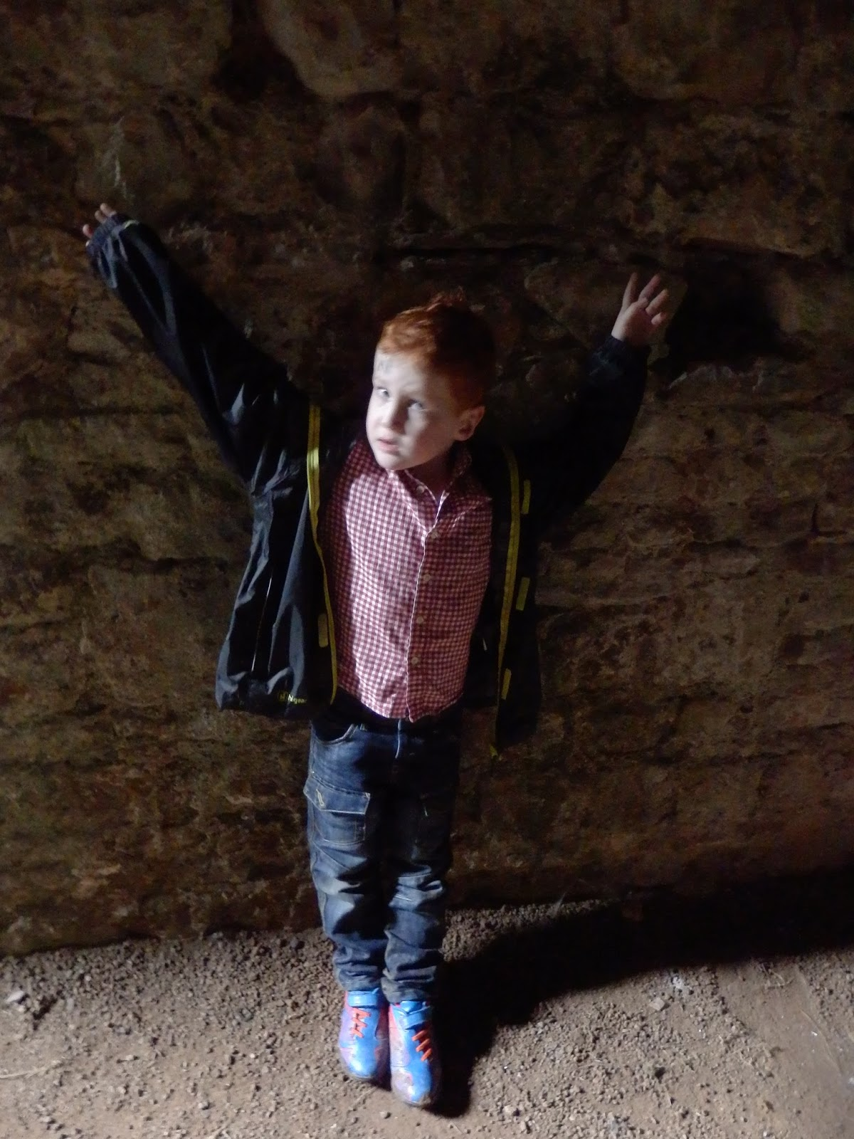 Ieuan pretending to be chained to the wall in the dungeon at Raglan Castle