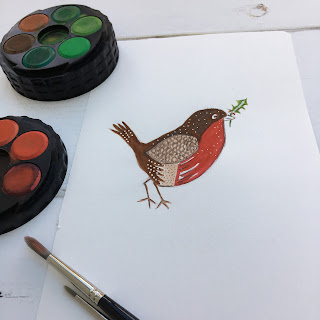 Robin painted with watercolours