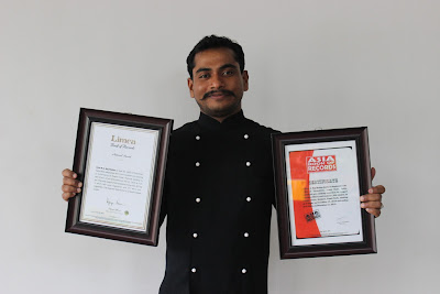 Chef M.S.Raj Mohan holding the Limca Book of Records certificate