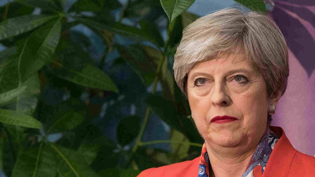May's Conservative remains largest party after snap election, but loses majority