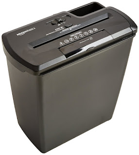 Destroys credit cards with AmazonBasics 8 Sheet Strip Cut Shredder plus CD Shred 21.59 GBP