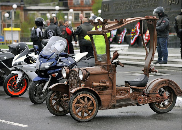 Carpenter shapes wooden motor tricycle , arts and entertainments