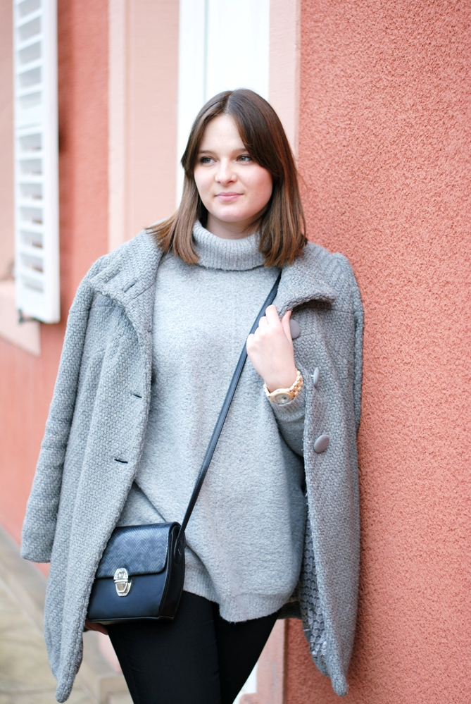 coat slinging and crossbody bag