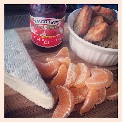 Garlic Crostini, Double-Cream Brie, Raspberry Jam, and Clementine Oranges | Taste As You Go
