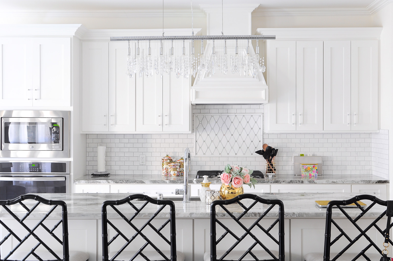 This white shaker kitchen is chic, bright and gorgeous when paired with the black dayna stools from Ballard Designs.