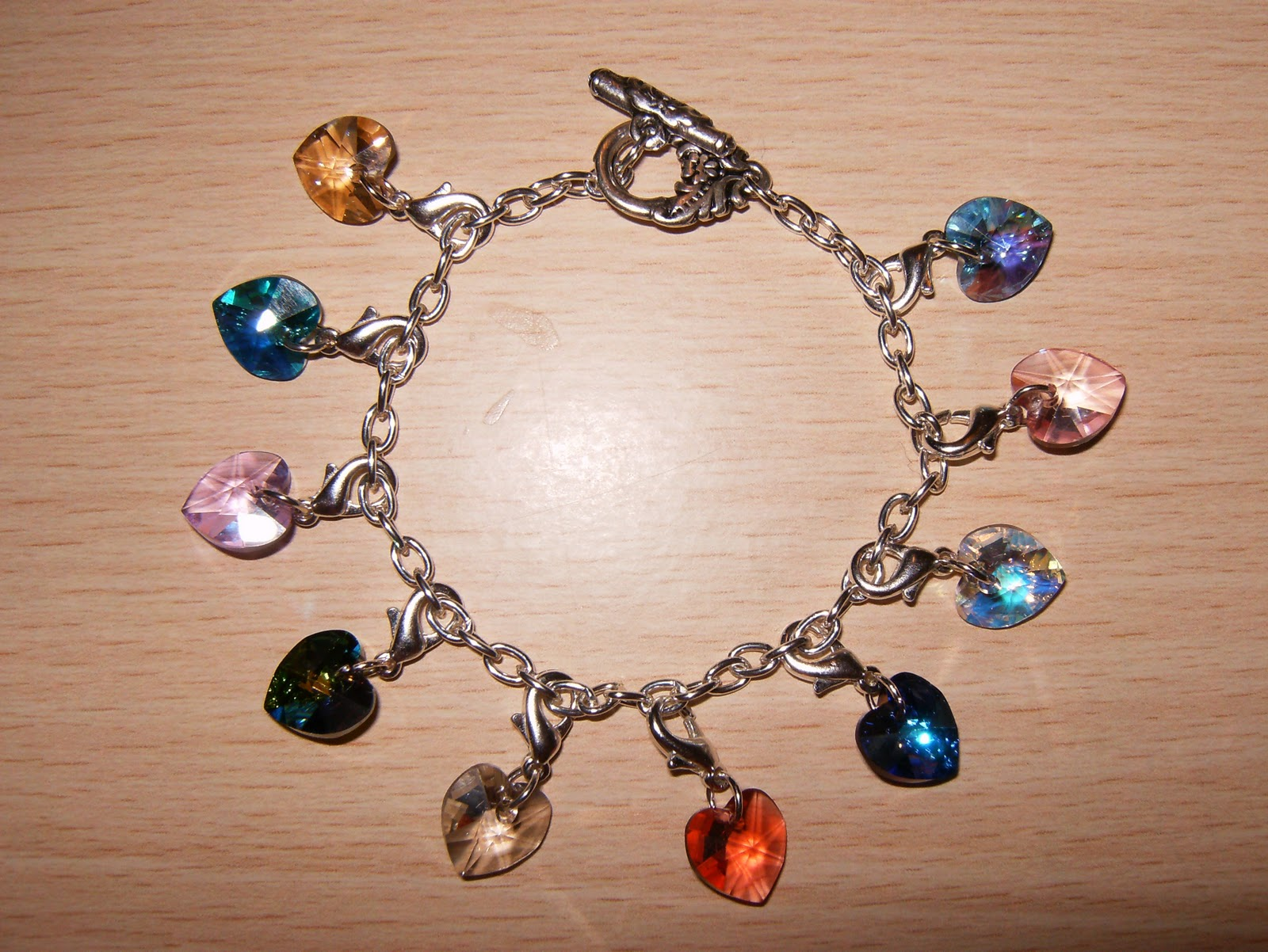 1eb02d339079 Pulseras de cristal de swarovski. Pulsera de charms swarovski de corazones  en diferentes colores