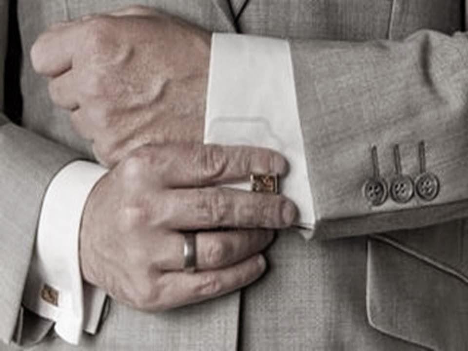 man adjusting cufflink