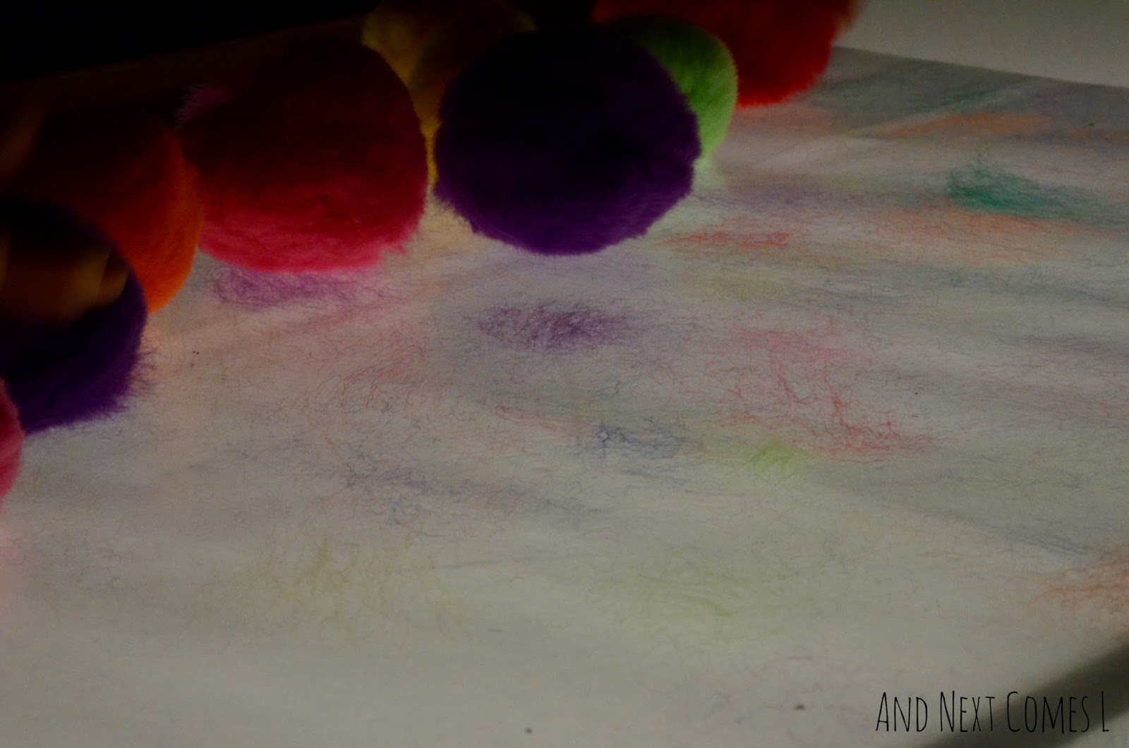 Sticky pom pom art on the light table from And Next Comes L