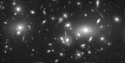 black and white photograph of lensed galaxies