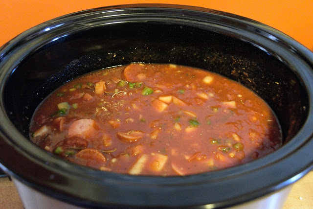 All the ingredients for the jambalaya stirred together in the crockpot.