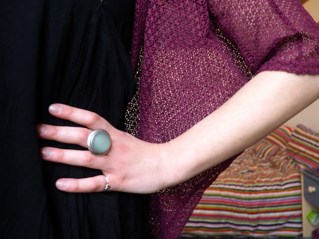 Pull the Lever   Disneybound Yzma outfit jewellery details of large round blue stone ring, with black slouch dress and pink knit cardigan