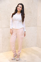 Kyra Dutt in Tight White Top Trousers at Paisa Vasool audio success meet ~  Exclusive Celebrities Galleries 033.JPG