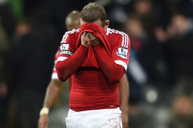 Disappointed: United captain Rooney reacts at full-time