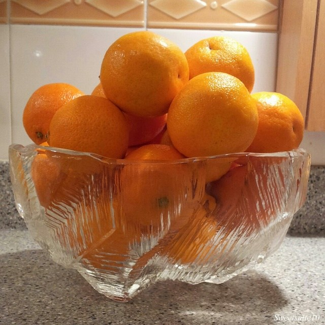 New Glass bowl filled with clementines