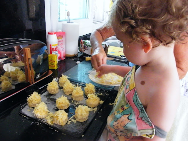 10. Sprinkle a generous amount of grated Cheddar over each scone.