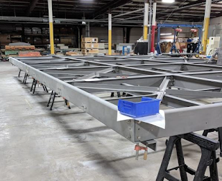 Pultruded FRP suspendible roof structure
