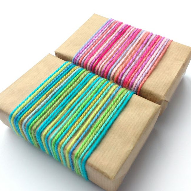 gifts wrapped with bright and colourful yarn scraps