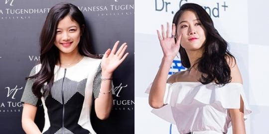 Pakai jumper kembar, Kim Yoo Jung vs Soyu Sistar keren siapa?