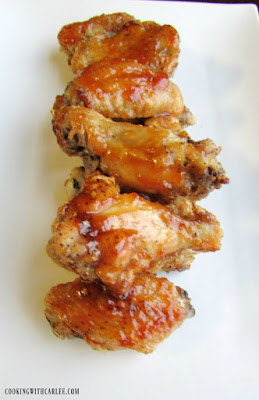 peach habanero chicken hot wings lined up on white background