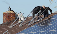 A new program in Connecticut aims to eliminate the cost barriers to rooftop solar energy for low-income households. (Credit: Alexandra Beier/Getty Images) Click to Enlarge.