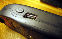 [Image: The USB connector seen from the outside, clearly with the rubber protection rendered useless.]