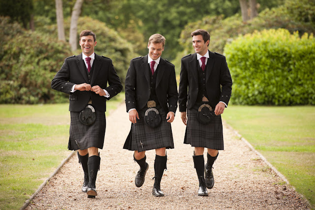 A picture of Three young gentlemen walking and wearing a semi-dress sporran kilt outfit