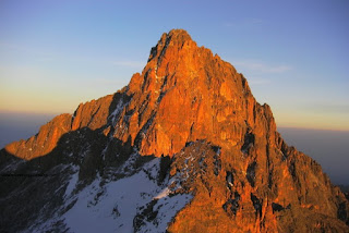 The peak of Mount Kenya just at the sunrise over the mountain proves to be the most breathtaking scene for Mount Kenya Climbing Expeditions group  tour