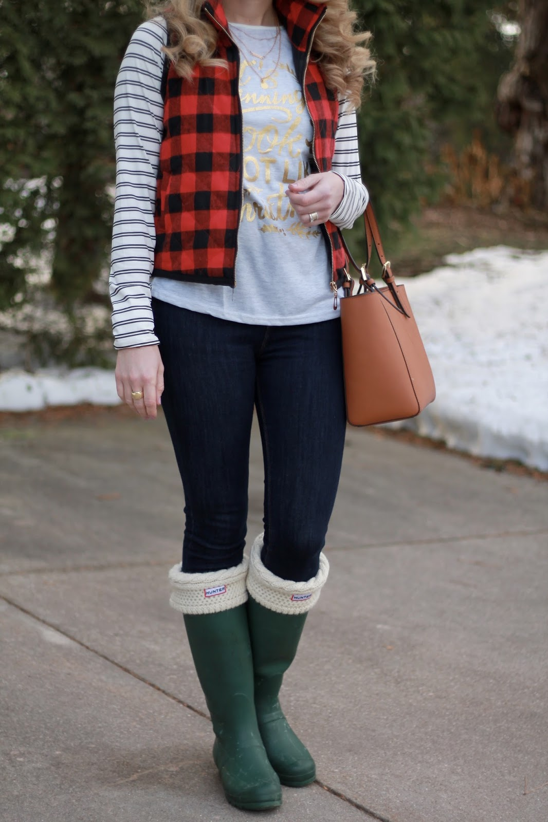 striped graphic tee, red plaid vest, Express dark skinny jeans, green Hunter boots, Tory Burch tote, layered necklace