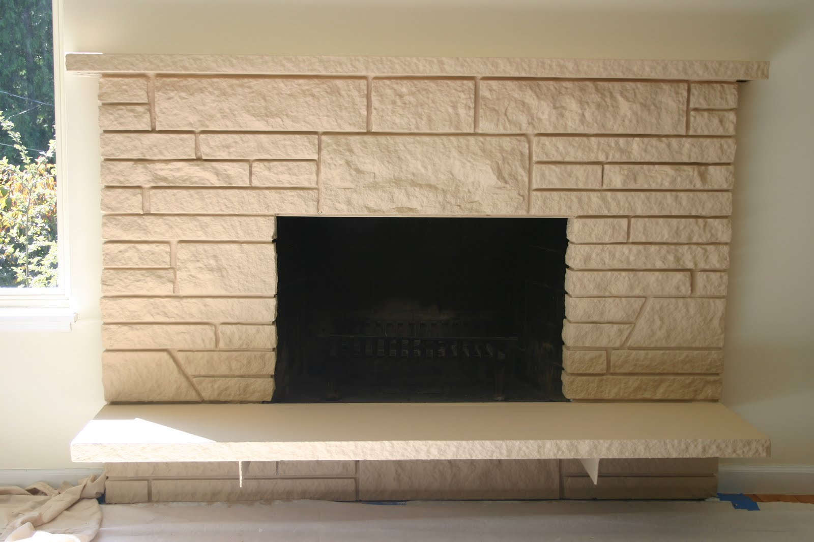 * Remodelaholic *: Restoring A Painted Stone Fireplace