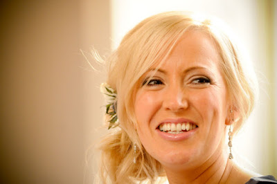 Reportage shot of bridesmaid at the top table on the day of her friends wedding