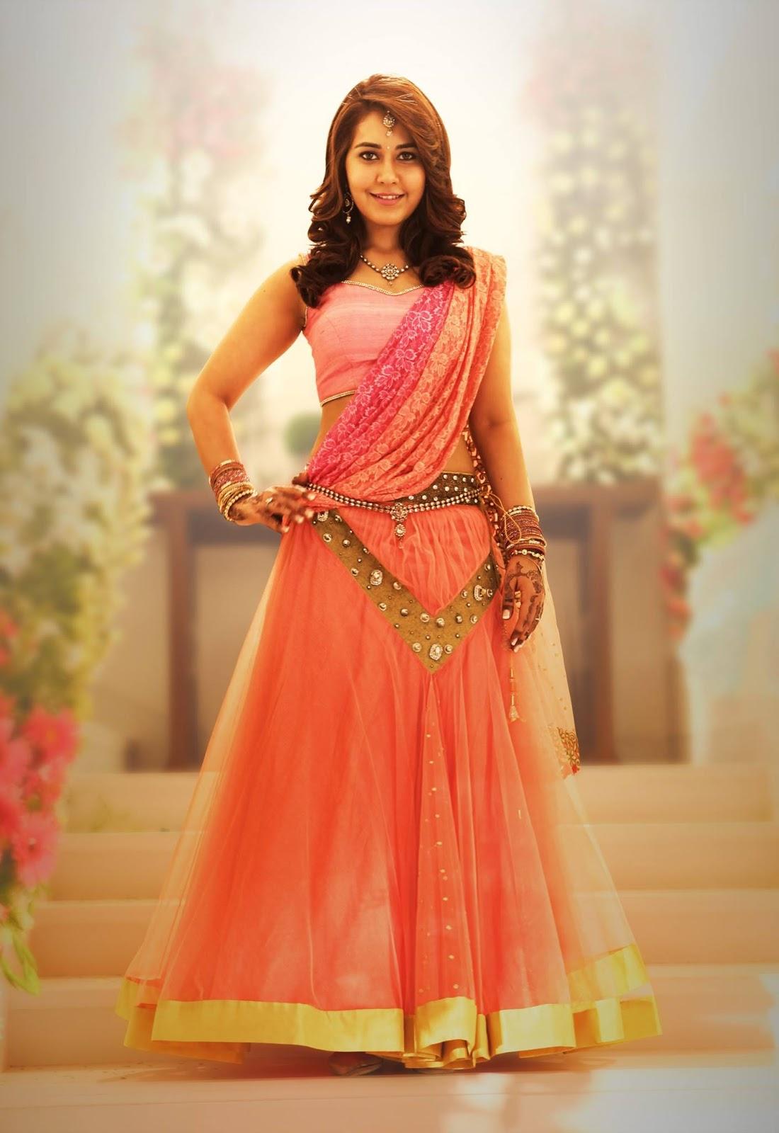 Rashi Khanna Hot Navel Stills In Orange Dress