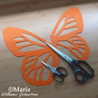 Orange butterfly wings and craft scissors