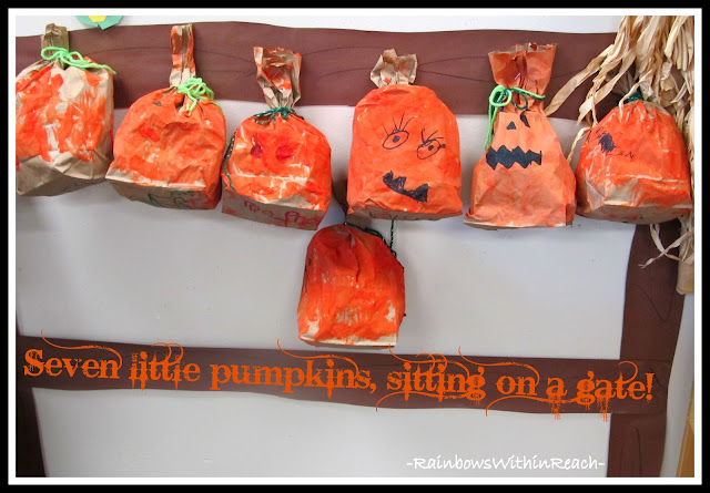 photo of: Three Dimensional Paper Bag Pumpkins Displayed on Gate (Bulletin Board) Via RainbowsWithinReach