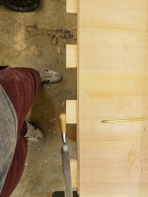 photo of the tabletop with four wooden tongues ready to slot into the breadboard pockets