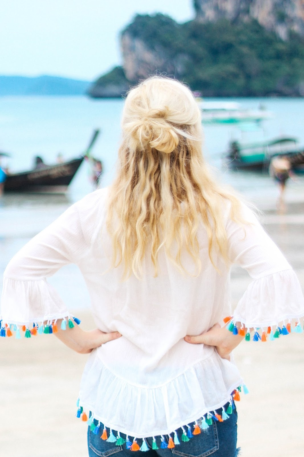 Global Fashion Gal (Brianna Degaston) wearing colorful tassels on vacation in Thailand.