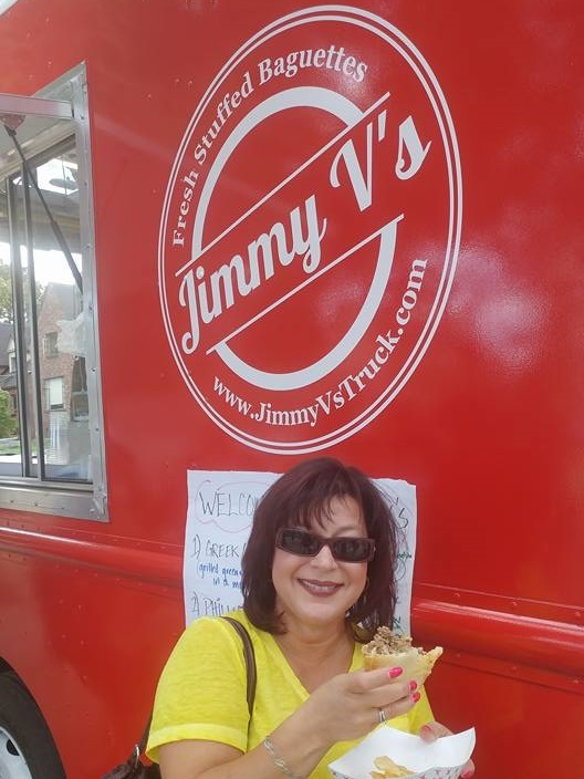 Chrissy in her shades outside Jimmy Vs Truck puts her lunch on hold to flash a smile for the camera