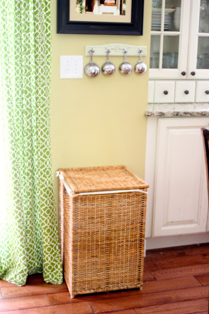 pet food storage in an Ikea wicker hamper via www.goldenboysandme.com