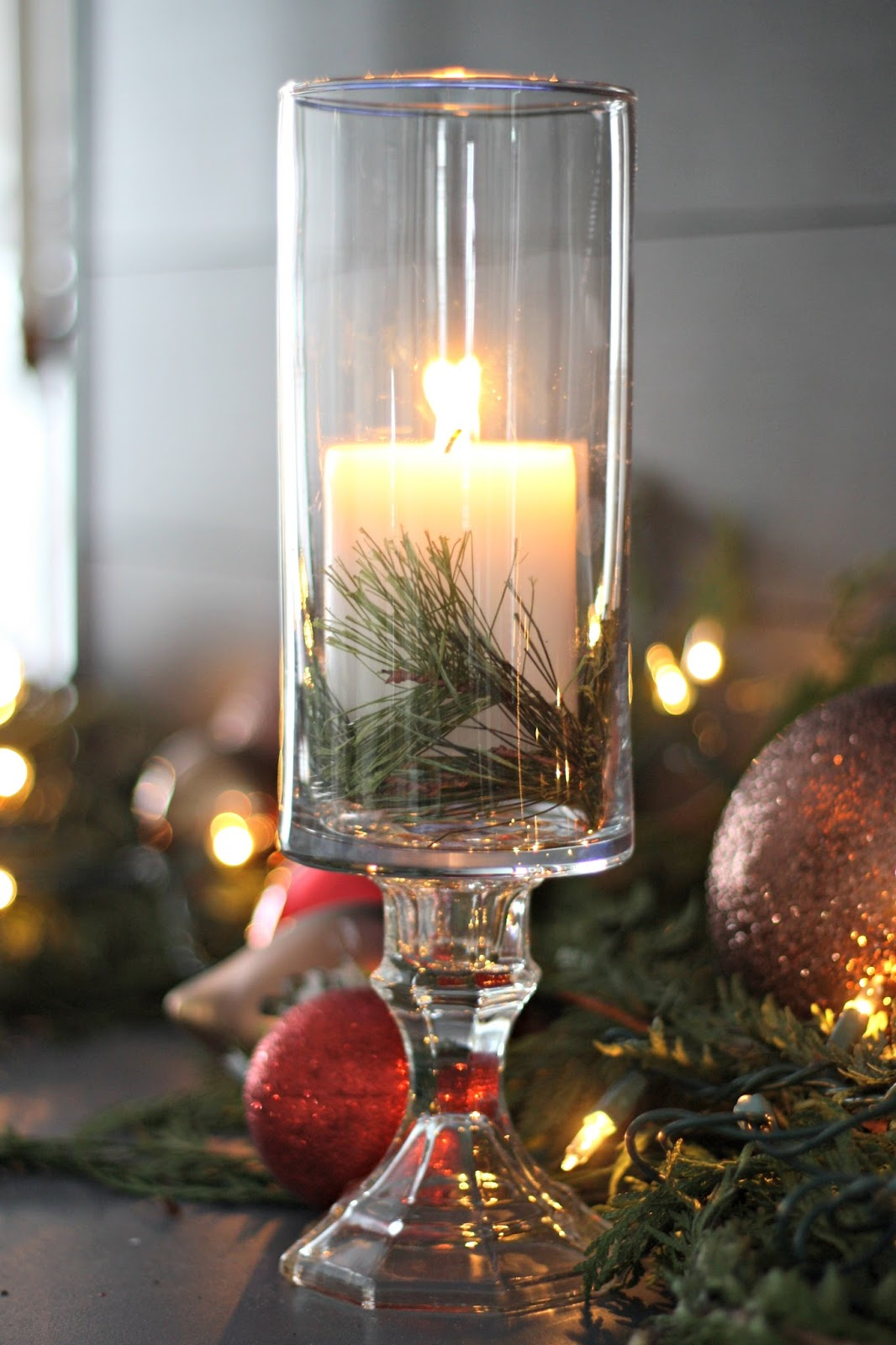 DIY dollar store pedestal candle with greenery