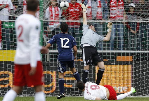 Poland striker Robert Lewandowski scores a goal against Andorra in an international friendly