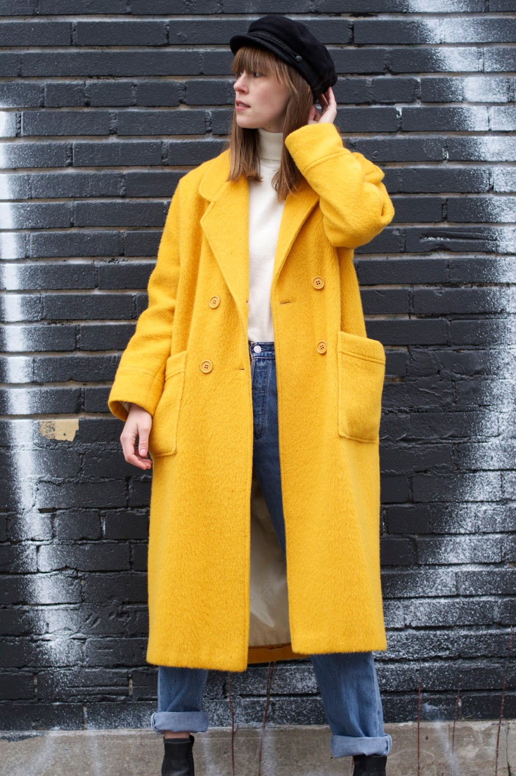 I'm wearing a yellow wool coat