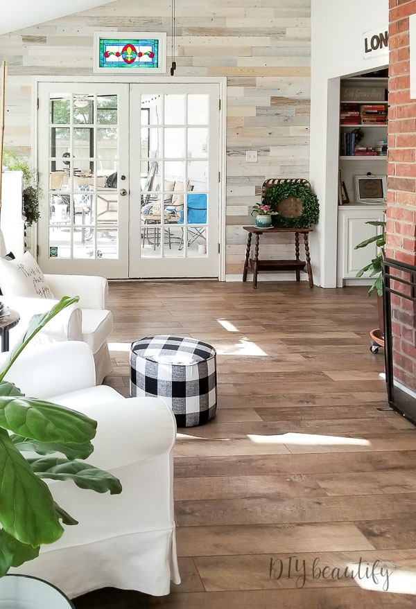 sun room with wood walls